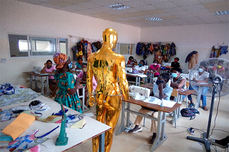 Group 3 women holding a training on title Cutting and Sewing mens attires